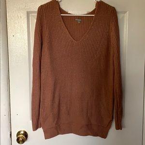 Dark, peachy colored sweater